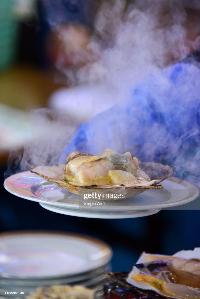 Serving Hokkaido grilled scallop : Stock Photo