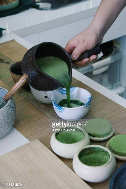 serving matcha green tea in traditional japanese tea bowls. - ceremony stock pictures, royalty-free photos & images
