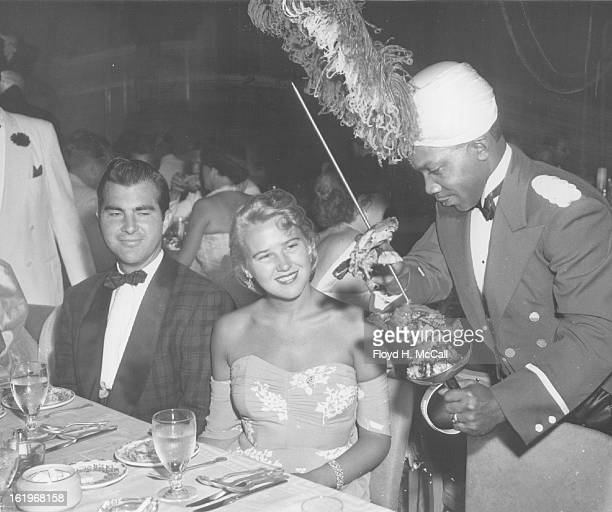 JUL 17 1953 Serving Mr and Mrs Harry Fisher Gates their roast duck Thursday evening at the opening of the new Talisman room at Wolhurst Saddle club...