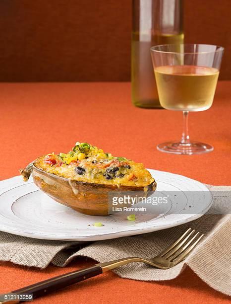 Serving of stuffed acorn squash w/glass of wine