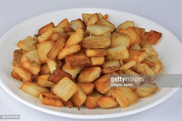 Serving plate of fried Hashbrown Potatoes (Solanum tuberosum)