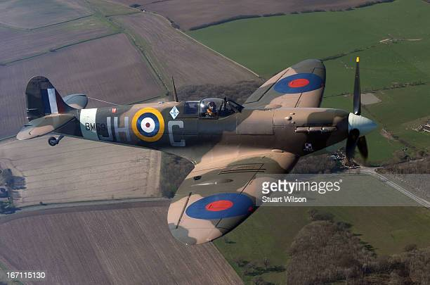 Serving RAF pilot Charlie Brown flies a Spitfire BM597 a combat veteran aircraft of World War Two over Kent as seen from a helicopter during the 'Fly...