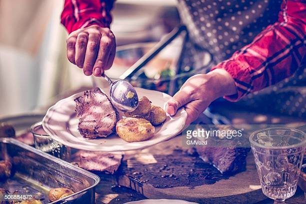 Serving Roast Beef with Potatoes and Root Vegetables
