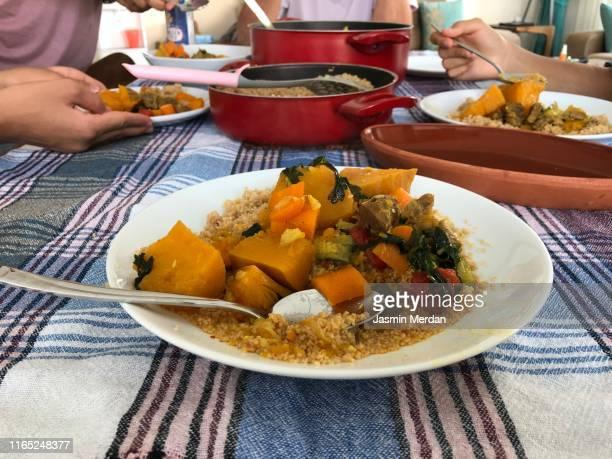 serving vegetable lunch on table at home - couscous photos et images de collection
