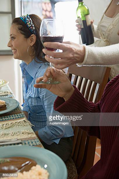serving wine at table - mole sauce stock pictures, royalty-free photos & images