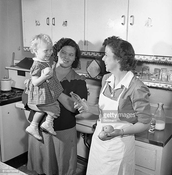 Serving young America Mrs Lacky finds most pleasure in aiding young mothers in charting their babies' food programs Healthy growing youngsters in...