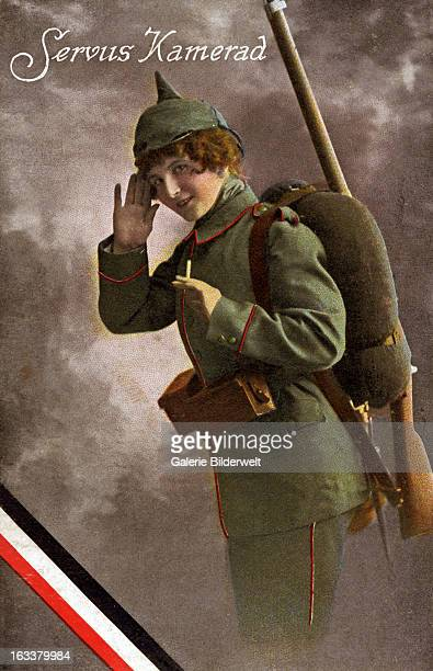 'Servus Kamerad' or 'Hello comrade' 1915 A young woman in a German uniform with a gun First World War Colored postcard