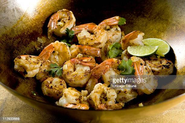 Sesame bok choy yellow peppers onions and spicy marinated shrimp saut¼ed up in a wok is a spicy treat