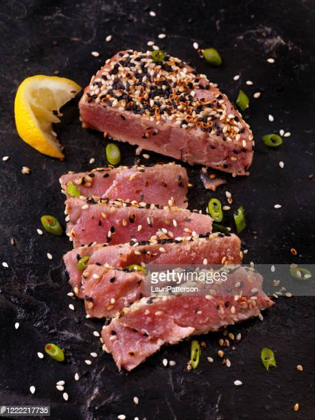 sesame crusted, seared tuna fillet - sesame stock pictures, royalty-free photos & images