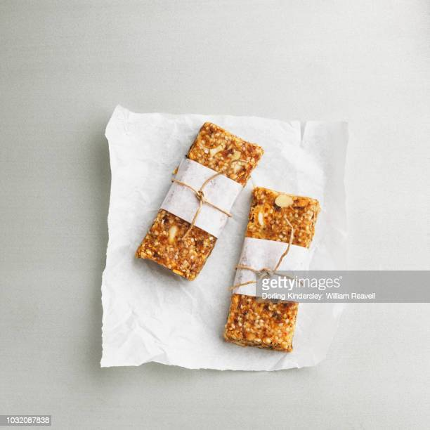 sesame power bars - wax paper stock photos and pictures
