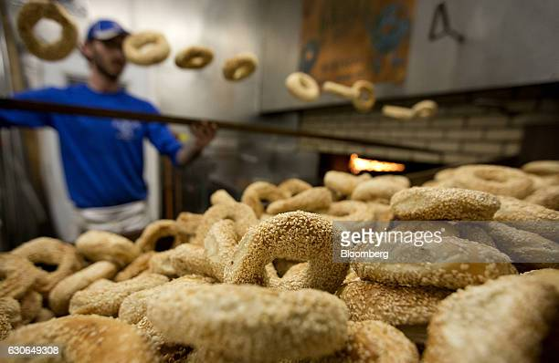 Sesame seed bagels are displayed for sale at StViateur Bagel Shop in Montreal Quebec Canada on Monday Dec 26 2016 Bloomberg Nanos Canadian Confidence...