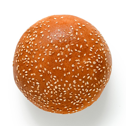 Sesame seed hamburger bun isolated on white. Top view. 1178954509