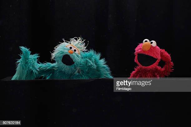 Sesame Street cast members Rosita and Elmo perform during the Sesame Street and HBO hosted Free Museum Day on January 30 2016 in Phoenix Arizona