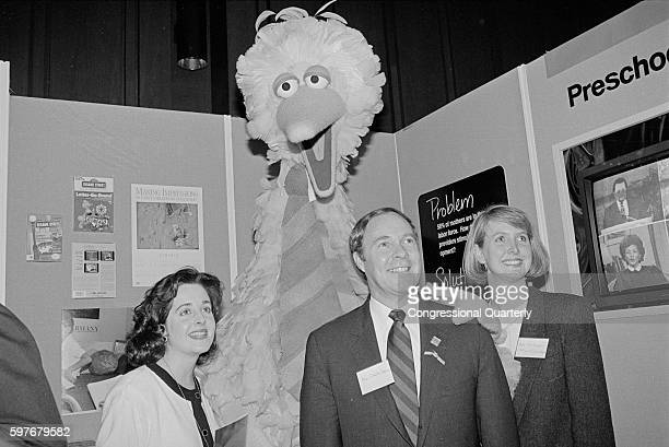 Sesame Street character Big Bird poses with Rep Claude Harris DAla his staff member Ann Stritzinger and another woman in March 1991