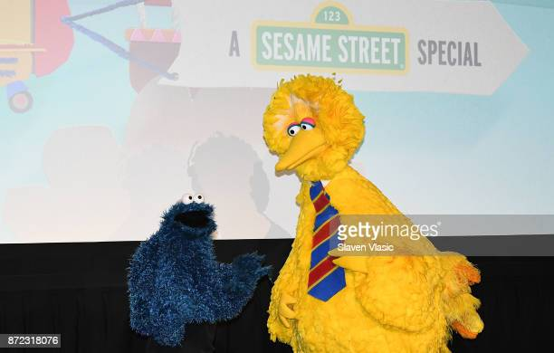 Sesame Street characters Cookie Monster and Big Bird attend HBO Premiere of Sesame Street's The Magical Wand Chase at the Metrograph on November 9...