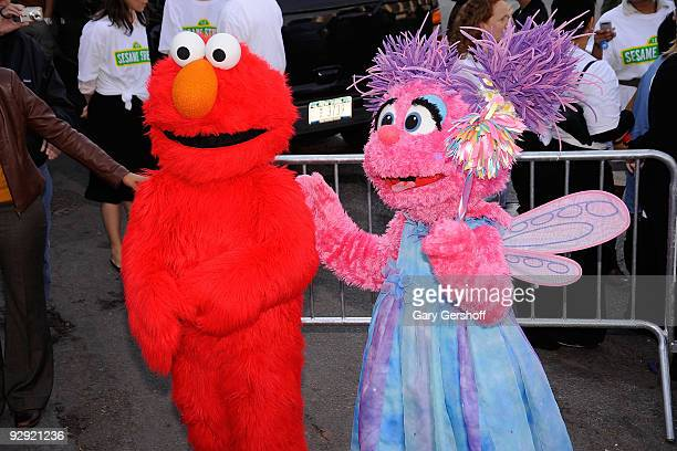 Sesame Street characters Elmo and Abby Cadabby attend the Sesame Street 40th Anniversary temporary street renaming in Dante Park on November 9 2009...