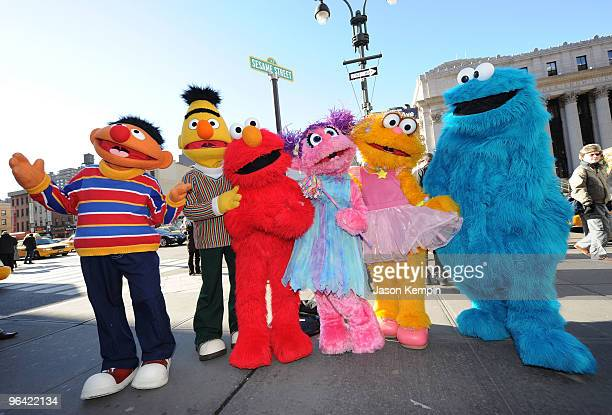 Sesame Street characters Ernie Bert Elmo Abby Cadabby Zoe and Cookie Monster attend the temporary street renaming to celebrate the 30th anniversary...