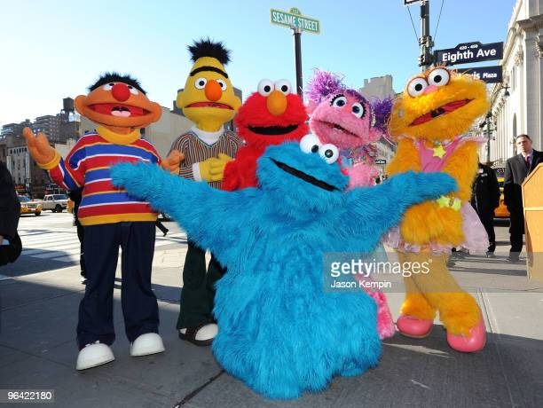 Sesame Street characters Ernie, Bert, Elmo, Cookie Monster, Abby Cadabby and Zoe attend the temporary street renaming to celebrate the 30th...