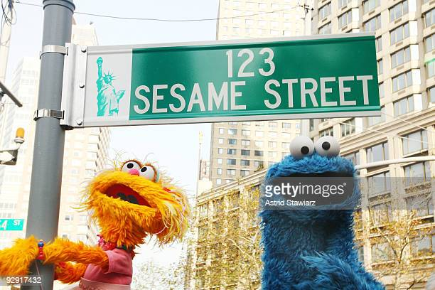 Sesame Street characters pose under a 123 Sesame Street sign at the Sesame Street 40th Anniversary temporary street renaming in Dante Park on...