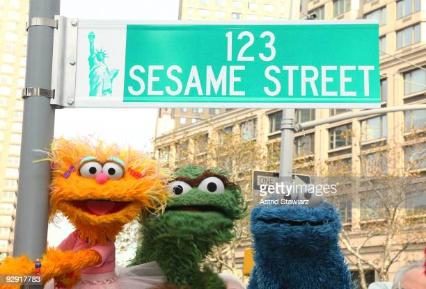 Sesame Street characters pose under a '123 Sesame Street' sign at the 'Sesame Street' 40th Anniversary temporary street renaming in Dante Park on...