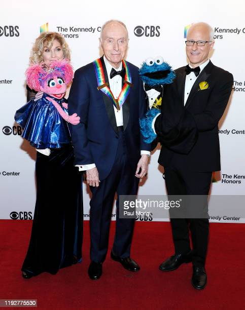 Sesame Street cofounder Lloyd Morrisett with Sesame Street characters Abby Cadabby and Cookie Monster attend the 42nd Annual Kennedy Center Honors...