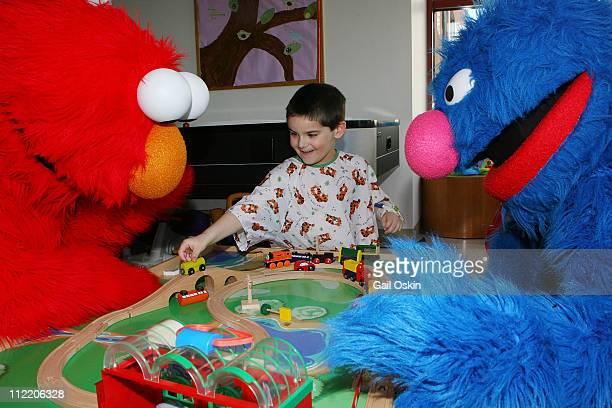 Sesame Street Live stars Elmo and Grover bring sunny days to Aiden at Children's Hospital Boston on April 14, 2011 in Boston, Massachusetts.