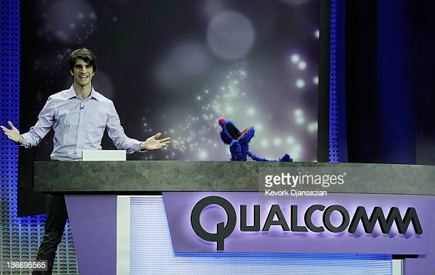 Sesame Street muppet charachter Grover appears during a presentation by Qualcomm at the 2012 International Consumer Electronics Show at The Venetian...