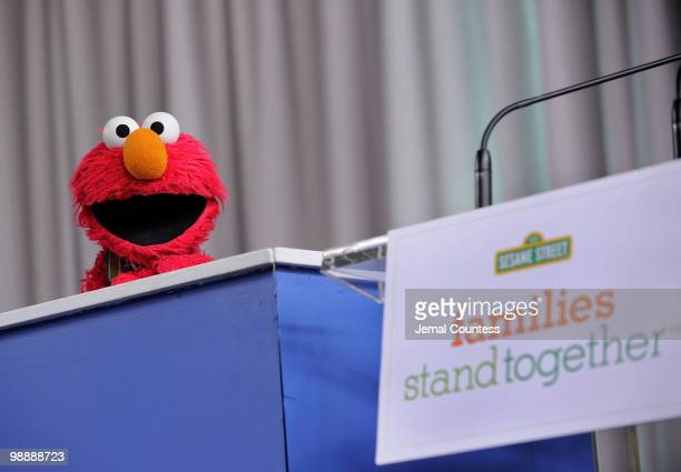 Sesame Street resident Elmo addresses the crowd at the screening of Families Stand Together Feeling Secure in Tough Times at the Children's Aid...