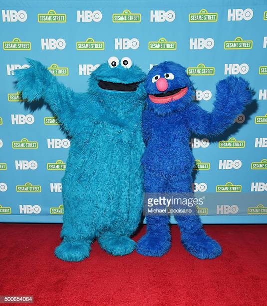 Sesame Street's Cookie Monster and Grover attend the Sesame Street/HBO Event at The New York Public Library on December 8, 2015 in New York City.