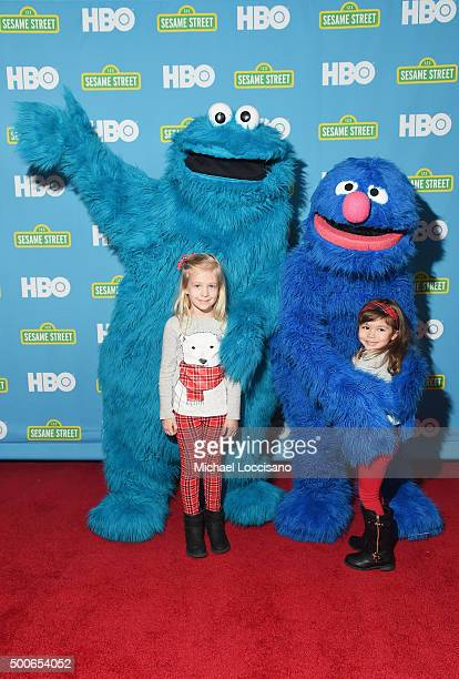 Sesame Street's Cookie Monster and Grover pose with young fans during the Sesame Street/HBO Event at The New York Public Library on December 8, 2015...