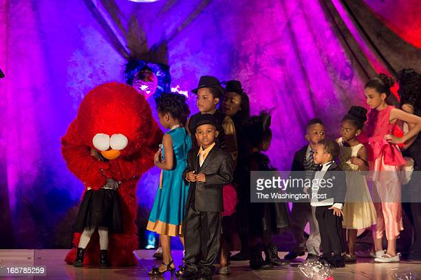 Sesame Street's Elmo surprises the children on stage during in the 3rd Annual Glynn Jackson's Show Biz Kidz at The Silver Spring Civic Building in...