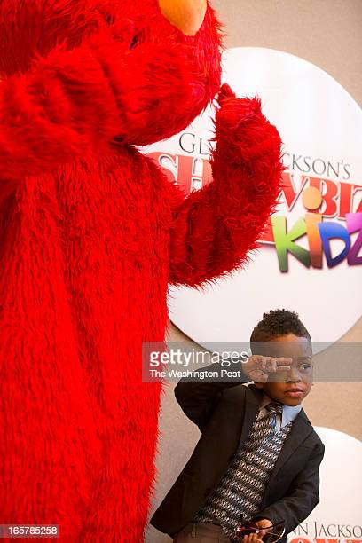 Sesame Street's Elmo takes a photo with Darius Yarborough 4 during the 3rd Annual Glynn Jackson's Show Biz Kidz at The Silver Spring Civic Building...
