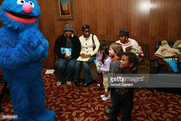 """Sesame Street's Grover plays with children at the """"Let's Get Ready!"""" bilingual outreach initiative at NewYork-Presbyterian/Weill Cornell on October..."""