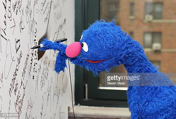Sesame Street's Grover signs the wall at AOL Build Speaker Series 'Sesame Street's Grover And The USO Dr Jeanette Betancourt And Rachel Tischler' at...