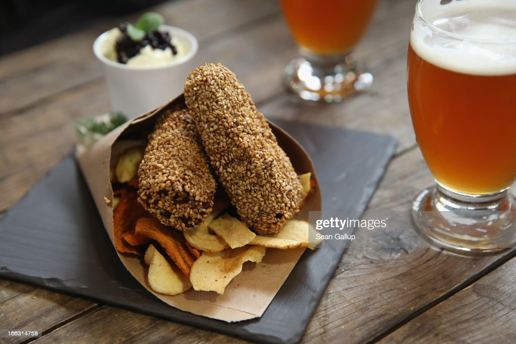 Sesame-covered fried fish served with vegetable chips and a caviar remoulade lie on a table on the first day of Street Food Thursday at the Markthalle Neun market hall in Kreuzberg district on April 11, 2013 in Berlin, Germany. Street Food Thursday features sidewalk delicacies from a variety of culinary traditions and will be open every Thursday from 5 until 11. Berlin has become a major tourist destination in Europe and has developed a reputation as a hip, affordable and open-minded city.