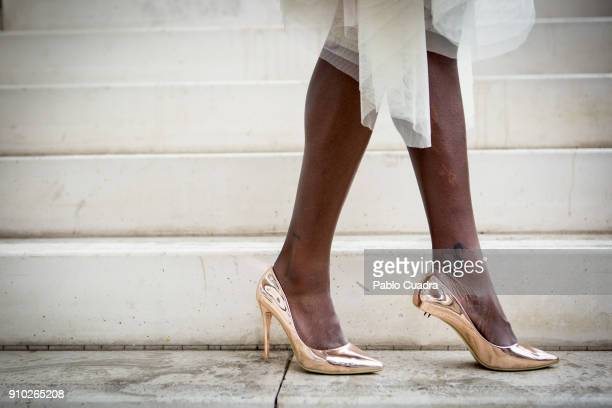 Sesinou wears Rives Brothers dress and shoes at Ifema during Mercedes Benz Fashion Week Madrid Autumn / Winter 2018 on January 25 2018 in Madrid Spain