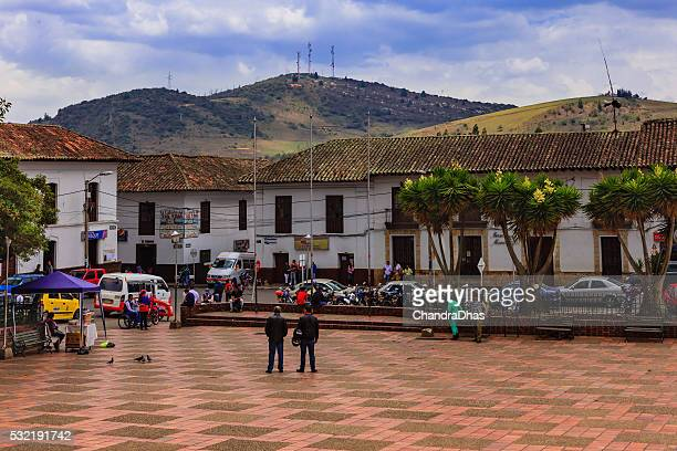 sesquilé, colombia: people and colonial spanish architecture on main square - cundinamarca stock pictures, royalty-free photos & images