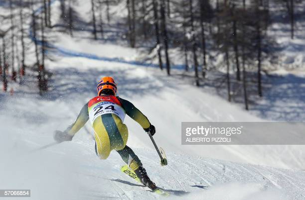 Australia' Michael Milton skies downhill during the men's superGstanding competition at the Turin winter paralympics 13 March 2006 in Sestriere...