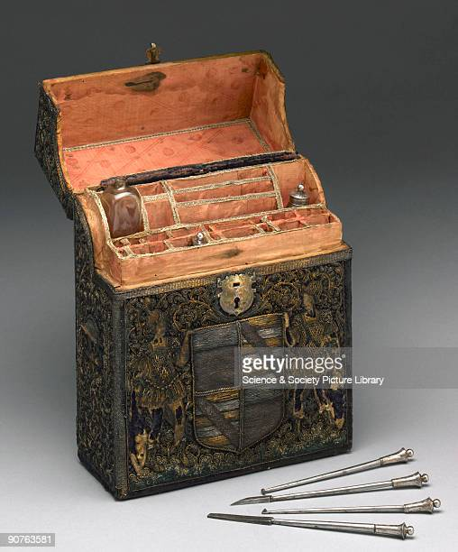 Set containing dental instruments and bottles in a chest covered with bullion embroidery showing the arms of the Bacon family of Redgrave Suffolk