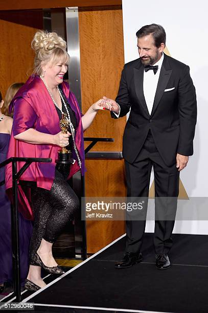 Set decorator Lisa Thompson winner of the Best Production Design award for 'Mad Max Fury Road' poses with actor Steve Carell in the press room during...