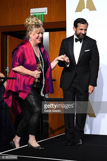 Set decorator Lisa Thompson winner of the Best Production Design award for 'Mad Max Fury Road' poses with actor Steve Carell poses in the press room...