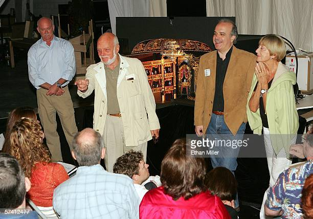 Set designer Paul Kelly director Hal Prince assistant director Artie Masella and choreographer Gillian Lynne speak to cast members in front of a...