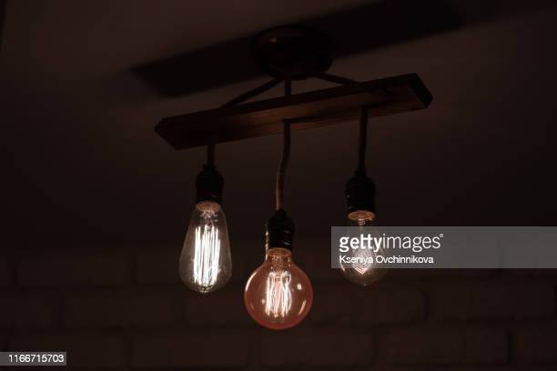set edison retro lamp on dark bokeh background of different shapes. - pendant stock pictures, royalty-free photos & images