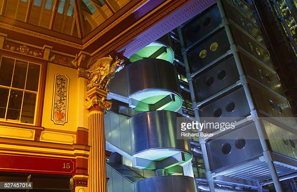 Set incongruously next to London's old Leadenhall Market we see the floodlit exterior of British architect Sir Richard Rogers' Lloyds building home...