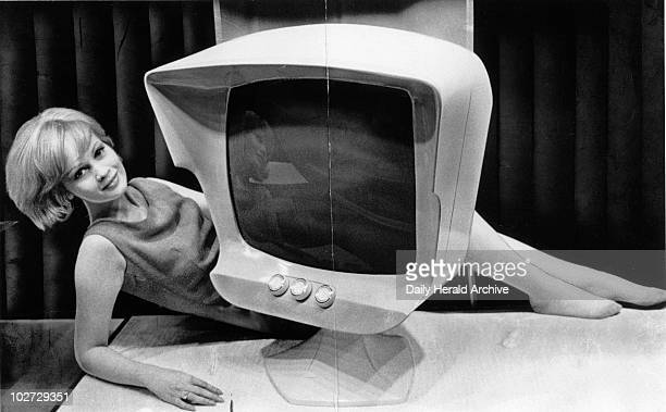 'TV set of 1971' 1961 PYE's idea of telev TV set of 1971' 1961 PYE's idea of television design ten years in the future A woman poses with the...
