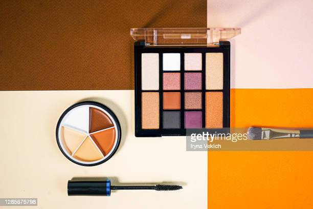 set of beauty products laid out on a colorful background. - アイライナー ストックフォトと画像
