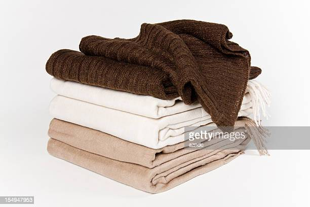 Set of blankets that are beige white and brown