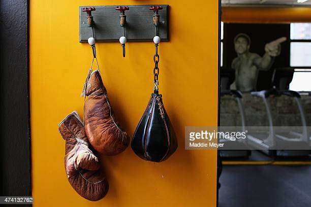 A set of boxing gloves hang on the wall at The Ring Boxing Club on May 20 2015 in Boston Massachusetts