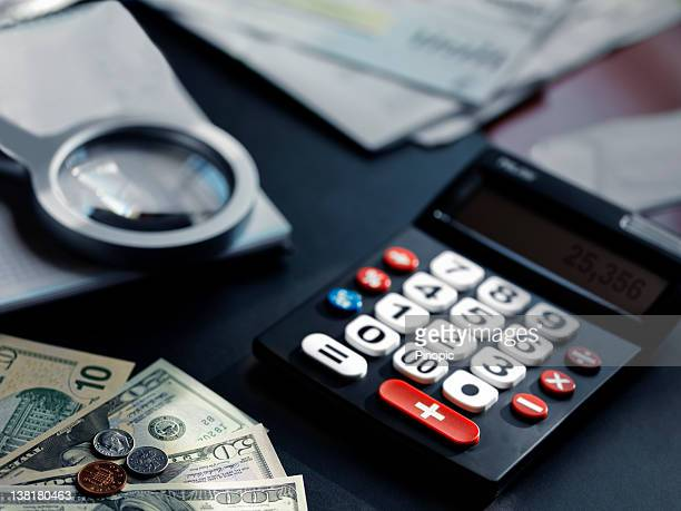 Set of Calculator, money, invoices and loupe