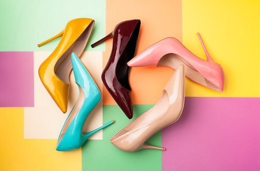 Set of colored women's shoes on a colored background 942924282